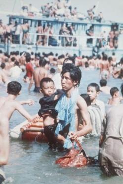 Malaysia - Refugees (boat people) wading ashore.
